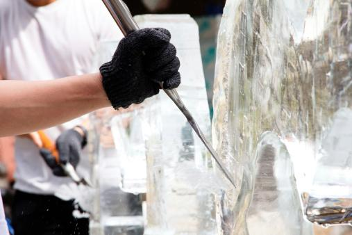 Ice Sculpting,Ice Carver Using Chisel to Carve