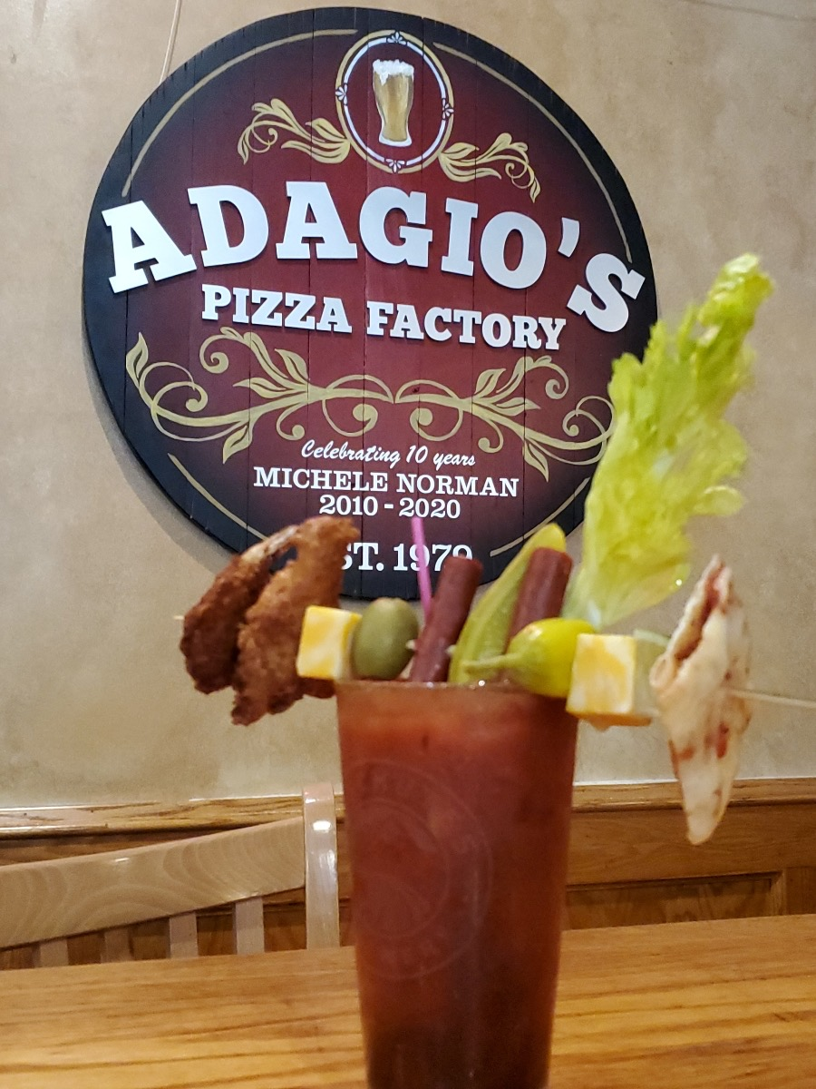 Bloody Mary with the Adagio's sign in the background