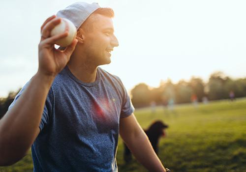 Casual softball game outdoors